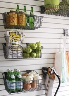 Hanging wire baskets on slat wall. Great in a basement, garage or pantry Diy Kitchen Storage, Pantry Storage, Wall Storage, Kitchen Pantry, Garage Storage, Storage Ideas, Storage Baskets, Food Storage, Storage Design