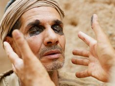 A blind man healed by Jesus is questioned by the Pharisees.  (John 9:1-41): Slide 5