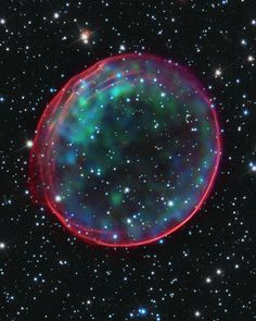 This image of supernova remnant 0509-67.5 was made by combining data from two of NASA's Great Observatories. Optical data of SNR 0509-67.5 and its accompanying star field, taken with the Hubble Space Telescope, are composited with X-ray images from the Chandra X-ray Observatory.