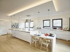 Scandinavian style minimal white and wood kitchen with recessed ceiling lighting
