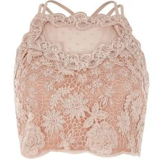 Checkout this Light pink lace mesh crop top from River Island