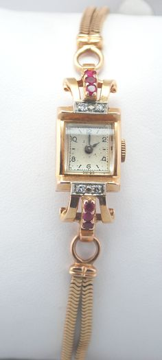 Diamond and Ruby yellow gold antique watch.