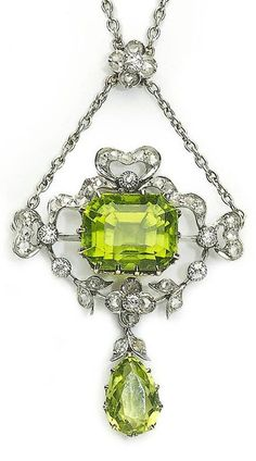 An Edwardian platinum, gold, peridot and diamond pendant, circa 1905. Set with an emerald-cut and a pear shape faceted peridot and with old and rose-cut diamonds mounted in platinum and gold.