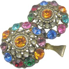Large Jewel-tone Art Deco rhinestone pierced metal clip earrings from the 1930's having a gilded pierced base metal setting are in very good vintage condition; certainly were inspired by the popular Thief of Baghdad genera of jewelry of the 1930's and early 1940's. Bearing patent number 1967965, issued on July 24, 1934, on their ornately scrolled clip backs. They function beautifully check them out with the scan able photos on brendastreasures on rubylane.com!