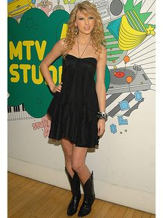 A more casual Swift rolled up to MTV Studios for TRL in her standard uniform of a cute little dress and cowboy boots. The layers and halter of the dress and the monochromatic color scheme made this outfit look chic rather than country bumpkin.
