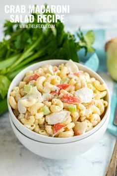 This Crab Macaroni Salad recipe is the perfect way to make a traditional macaroni salad extra special! A creamy, delicious mac salad with crunchy celery, onions and meaty chunks of crab meat (or imitation crab meat). You'll want to make this family favorite again and again! Shrimp Macaroni Salad, Crab Pasta Salad, Summer Side Dishes, Side Dishes Easy, Quick Dinner Recipes, Side Dish Recipes, Fruit Salad Recipes, Fruit Salads, How To Make Macaroni