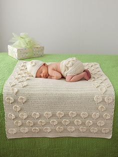 """Adorable does not even begin to describe this darling little crochet set for baby! Pattern includes a blanket, hat and diaper cover. Model made using Berroco® Comfort® worsted-weight yarn. The blanket measures 25""""W x 31""""L and requires 5 skeins; hat uses 1 skein and includes Baby (Toddler); diaper cover uses 1 skein and fits 0-3months (6-12 months). Hearts are made as you go."""