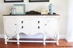 Oh my goodness....is this not the most beautiful buffet in the whole wide world?  I LOVE. LOVE. LOVE. it!  I love the mix of wood and paint!  Look at those details!  This is a piece painted with Annie Sloan Chalk Paint!