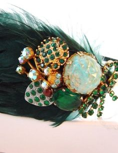 You would have to be a very confident bride to pull this off but its gorg   Forest Green Feather Hairband