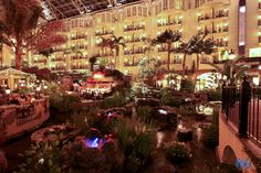 The Gaylord Opryland Resort at night. This beautiful hotel in Nashville, TN is a must do and so much more than just a hotel. Let us tell you all about it. www.facebook.com/thesource4travel