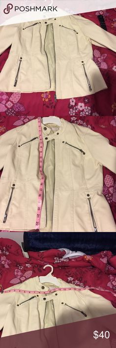 Cream faux leather jacket Lightly worn cream faux leather jacket with a minor pen mark. Four packer zippers Jackets & Coats