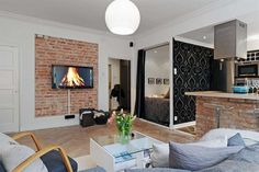 Pomysł na ścianę w salonie: kamień, tapeta