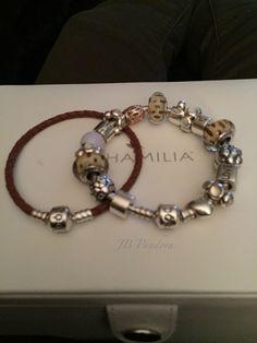 Pandora brown leather bracelet 590705CBN and Pandora silver bracelet. Snow leopard muranos.