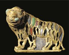 A Rare Bactrian Gold Pendant in the Form of a Lion Inlaid with Lapis Lazuli, Carnelian, and Turquoise    Gold with lapis lazuli, carnelian, and turquoise, early second millennium B.C.E.