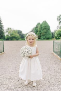 Flower Girl with gypsophila flower crown and posey | Pastel pink, Mint Green & White Colour Scheme with Gold Accents | Stately Home Country Wedding Venue | Outdoor Ceremony | Marquee Reception | Photography by Sarah-Jane Ethan | http://www.rockmywedding.co.uk/simone-tim/
