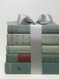 Table centerpiece, pretty vintage books tied with a satin ribbon/bow Old Books, Vintage Books, Party Decoration, Table Decorations, Book Centerpieces, Centre Pieces, Book Nooks, Book Gifts, I Love Books