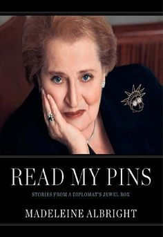 Read My Pins by Madeleine Albright, http://www.amazon.com/dp/B002RUA5EC/ref=cm_sw_r_pi_dp_QLQztb19DYCQR