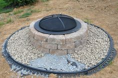 DIY fire pit. I like the idea of the gravel surround for safety. No kids allowed to walk onto the gravel.
