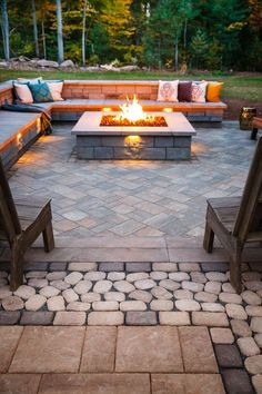 a patio clad with stone and stone benches with a wooden top for cozy sitting by - Backyard Designs