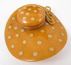 bakelite hat brooch