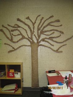 "I've always liked having a ""tree"" in my classroom to use for showing the change of seasons and for displaying children's artwork.  It always makes for a good ""group"" project.  This is how it looks in Sept., before we do anything to it.  It is made of rolled kraft paper (in the mailing supply section of the store), and is velcroed to the wall.  The trunk is stuffed with newspaper."