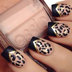 Leopard print nail design with gold striping tape and chevron style black tips