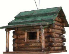 This classic hand made rustic wooden bird house will have your feathered friends feeling at home in no time. Sturdy wood construction, heavy duty wire hanger. #birdhouses #woodenbirdhouses