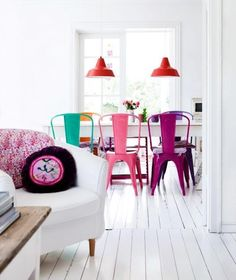 colorful dining and living room | red lamps | pastel chairs | pillows | wood planks | Scandinavian