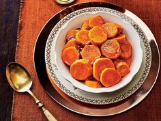 Classic Candied Yams Recipe | Candied yams are a classic Southern side dish, especially when it comes to Thanksgiving. Even though Mama makes the same sweet potato casserole every year, she won't be offended if you bring these candied yams once she tries them. Lightly spiced and oh-so-sweet, these candied yams will become a mainstay in your Thanksgiving recipe lineup. Cinnamon, nutmeg, and vanilla combine with sweet potatoes for the most comforting holiday dish you can serve.