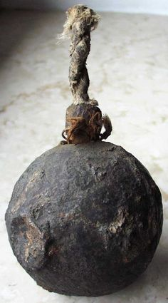 Small Thirty Years War iron hand grenade retaining its original filling and wooden fuse.