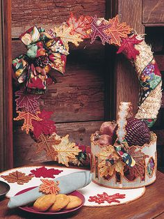 Fill your home with these beautiful fall accessories, including a wreath, basket and table trimmings. Plastic Canvas patterns for fall (aff link)