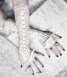 Alabaster Maiden Victorian Corset Laced Up Arm Warmers - Pale Ivory Floral Lace & Ribbon - Vampire Gothic Tribal Goth Lolita Bridal Cream. $44.00, via Etsy.