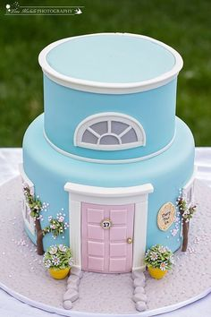 - Mary Poppins themed cake: 17 Cherry Tree Lane, whimsical version. Customer added a black silhouette topper of Mary Poppins. House
