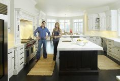 In the kitchen  the epicenter of the house, and Giuliana Rancic's favorite room  a large island is made of honed white Calcutta ducale marble, sanded down to look old and worn. It's typical of what the couple saw during their Italian travels, Bill Rancic said.