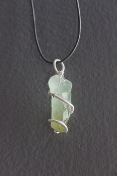 Green Calcite Crystal Wrapped in Silver Wire by ParagonStones