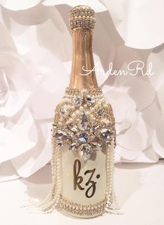 Can be made in any color! Bedazzled Liquor Bottles, Glitter Champagne Bottles, Decorated Liquor Bottles, Bling Bottles, Liquor Bottle Crafts, Decorated Wine Glasses, Crystal Champagne, Glitter Wine, Wedding Champagne