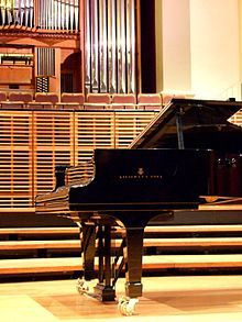 Steinway concert grand piano on the stage in Verbrugghen Hall, Sydney Conservatorium of Music – The University of Sydney, Australia