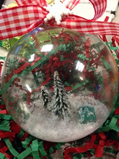 Glass ornament with miniature evergreens and a monopoly house. I used foam and shredded it with a cheese grader.