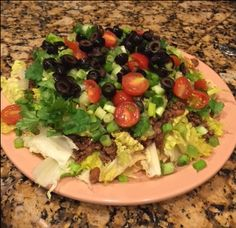 TACO SALAD - 2/5/17 - Very good! Meat Mixture: 1 1/2 lbs lean ground beef; 3/8 cup Taco Seasoning; 4 cloves of sliced garlic; 1/2 tsp oregano; S/P; (Add a bit of chili powder and/or cumin for spicier option.)  Salad Making: Tortilla Chips;  Lettuce; Above cooked meat mixture; Avocado Slices (or store bought guacamole); Green Onions; Black Olives;  Grated Mexican Cheese Blend; Cherry Tomato's; Jalapenos; Sour Cream;  Fresh Cilantro; Fresh Lime Juice;   Choice of Salad Dressing or Salsa