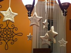 Made these out of salt dough and then painted with glittery paint. They are hanging on our dinning room chandelier with some silver ribbon.
