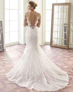TABATHA // A low illusion back and cap sleeves give a trendy look to a classic lace wedding dress