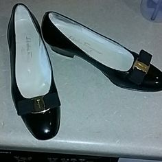 Salvatore Ferragamo pumps shoes bow 7.5 A heels aa I'm on vacation. This item will ship promptly after May 1st. 2016. Black patent leather pumps by ferragamo italy. Size 7 1/2 (2 A) A means narrow width. Authenticity guaranteed. Pre-owned in very clean overall very good condition. In my opinion these will best fit a shoe size 7. Salvatore Ferragamo Shoes Flats & Loafers