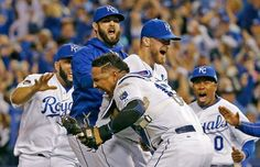 Kansas City Royals catcher Salvador Perez, and relief pitcher Wade Davis celebrate after their 4-3 win against the Toronto Blue Jays Game 6 of baseball's American League Championship Series on Friday, Oct. 23, 2015, in Kansas City, Mo.