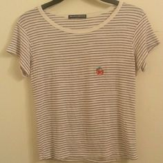 Brandy Melville cherry patch shirt Very light pilling but still in great condition. Brandy Melville Tops