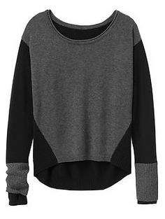 Merino Frisco Sweater - Stay warm when you layer on this colorblocked Merino wool neck sweater with a high-to-low hem and hidden thumbholes.