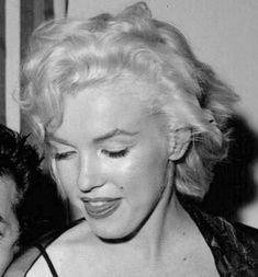 Marilyn at a birthday party for Sammy Davis Jr., December 1954.