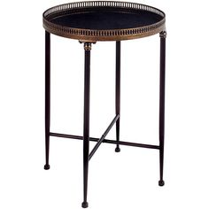 Give your favorite trinket or decoration an accent table of its own with this handmade Argento round accent table. This black accent table is ideal for creating a new focal point in your home.