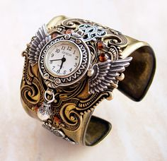 This steampunk cuff watch is a must-have accessory for every Steampunk scientist or adventurer. It will tell time, while reminding you how precious it is. Time does fly.   This is not just a women's cuff, its size and theme makes it suitable for the gentlemen as well.