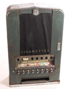 Art Deco design and font. on Feb 2017 Cigarette Vending Machine, Florence Nightingale, Vending Machines, Art Deco Design, Modernism, Vintage Beauty, Coffin Nails, Clocks, 1940s