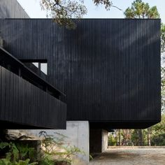 "Miami's Magaldi Studio used charred wood and dark stone to blend this boxy house ""as a shadow in the green surroundings"" of Valle de Bravo, Mexico. Exposed Concrete, Concrete Wall, Houses Architecture, Basement Floor Plans, Charred Wood, Mug Design, Dark House, Inspiration Design, Ground Floor Plan"